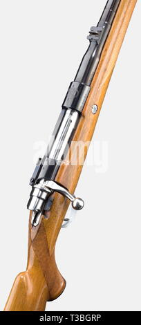 An FN Browning repeating rifle, 10.75 x 68 calibre. No. B 58353. Flawless, completely blued barrel with bright bore. Length 60 cm. Mauser 98 action. Side safety. Hinged magazine floor plate. Crisp trigger pull. Magazine floor plate and trigger guard display restrained, hand engraved buffalo and lion in a landscape between decorative plants, signed 'Vandermissen'. Outstanding lacquered light walnut stock with sharp chequering, cheekpiece, ventilated recoil pad, and two sling swivels. Length from trigger to the centre of the recoil pad: 35 cm. Fixe, Additional-Rights-Clearance-Info-Not-Available - Stock Photo