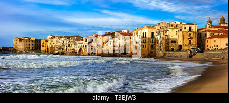 Traditional colorful houses,sea and beach over sunset,Cefalu' village,Sicily,Italy - Stock Photo