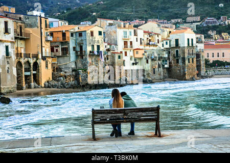Impressive Cefalu' village ,traditional houses and sea over sunset,Sicily,Italy - Stock Photo