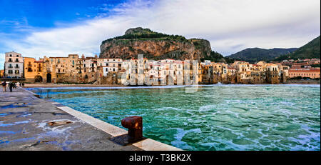 Traditional colorful houses and sea,Cefalu' village,Sicily, Italy - Stock Photo