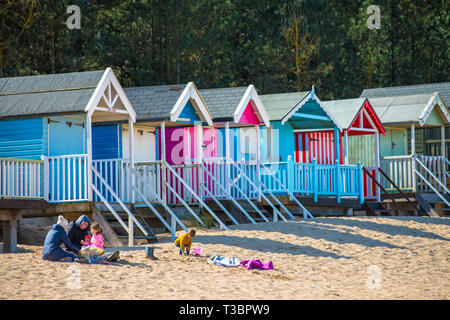 Colourful beach huts on Wells beach at Wells next the Sea on North Norfolk coast, East Anglia, England, UK. - Stock Photo