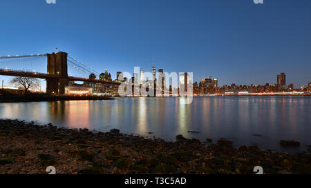 USA, New York City, Downtown Financial district of Manhattan, One World Trade Center and the Brooklyn Bridge - Stock Photo