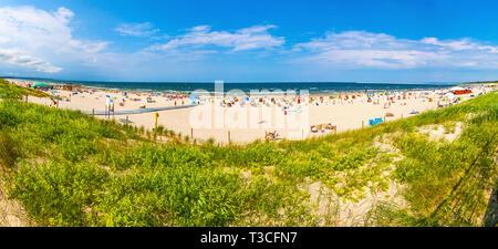 Swinoujscie, Poland - July 7, 2014: Panoramic view of crowded Baltic sea beach on Usedom island in Swinoujscie city, Poland - Stock Photo