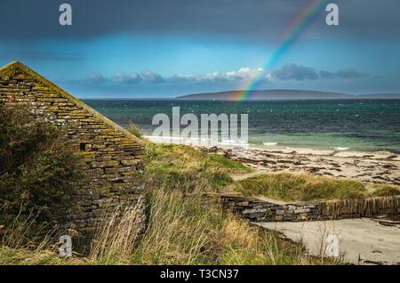 Rainbow over Eynhallow Sound from Evie, Mainland, Orkney Islands. - Stock Photo