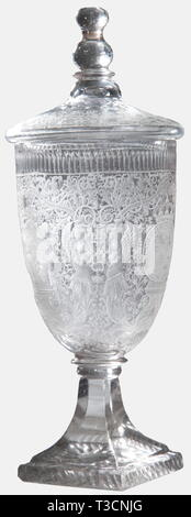 Prince William V Batavus of Orange (1748 - 1806), a lidded goblet with the coat of arms for the Netherlands Stadtholder Silesian work around 1780/90. Colourless cut glass, both clear and matt, the bell-shaped cup is excessively decorated. The front displays the Prince's crowned coat of arms within the ribbon of the Most Noble Order of the Garter, surrounded by fine vine work with mytholocical creatures and allegorical figures. Quadrangular base with prisms and stars cut into the bottom. The lid is decorated en suite and has a facetted, round fini, Additional-Rights-Clearance-Info-Not-Available - Stock Photo