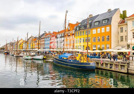 Copenhagen, Denmark - October 6, 2018: Copenhagen in the fall nyhavn is especially popular place in Copenhagen a lot of tourists walking around the ca - Stock Photo