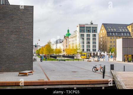 Copenhagen, Denmark - October 6, 2018: Copenhagen in the fall, people are walking around the square near the stork fountain, taking selfies sitting in - Stock Photo