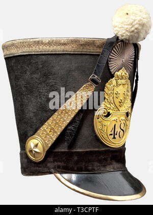 A model 1818 shako for officers of the 48th Line Regiment, Second Restoration (1815 - 1830) Tall, black felt body, with a leather top, gilt stamped emblem with the French coat of arms, the regimental number '48', silver-plated metal cockade, white wool pompom, brass metal chinscales on stamped star rosettes, black velvet lower band, leather peak with gilt brass edging, and completely preserved leather lining. The feather plume missing. Height 27 cm. Remarkably well-preserved headgear. historic, historical, 19th century, French Restauration, Franc, Additional-Rights-Clearance-Info-Not-Available