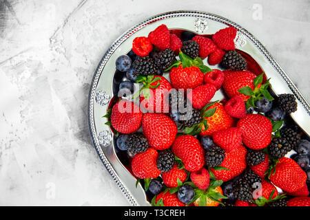 Berries raspberry blackberry strawberry on white b - Stock Photo