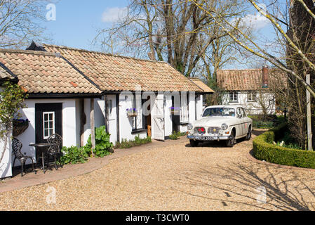 Thriplow, Cambridge, England, UK - March 2019: Old vintage classic 1968 VOLVO 100 Series 122 S car parked in the yard of British country house - Stock Photo