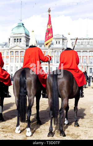 Queens Life Guards holding the household flag on Horse guards Parade London - Stock Photo
