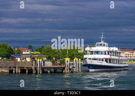 The MS ST. GALLEN, an excursion boat of the Schweizerische Bodensee Schifffahrt company has docked at the landing stage in Langenargen, Germany. - Stock Photo