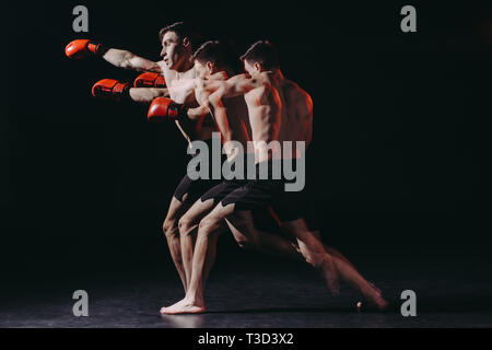 sequence shot of shirtless muscular boxer in boxing gloves doing punch - Stock Photo
