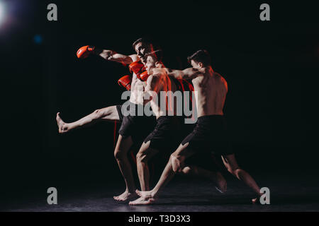 sequence shot of shirtless boxer in boxing gloves doing punch - Stock Photo