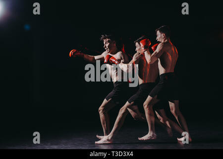 sequence shot of handsome shirtless muscular boxer in boxing gloves doing punch - Stock Photo