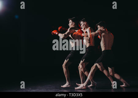 sequence shot of strong shirtless muscular boxer doing punch - Stock Photo