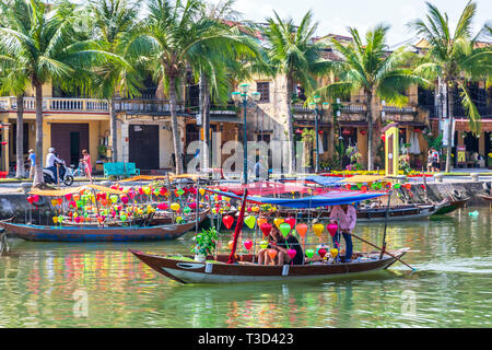 Tourists being taken for a sail on a lantern boat along the River Son Thu Bon, at Hoi An, Quang Nam Provence, Vietnam, Asia. - Stock Photo