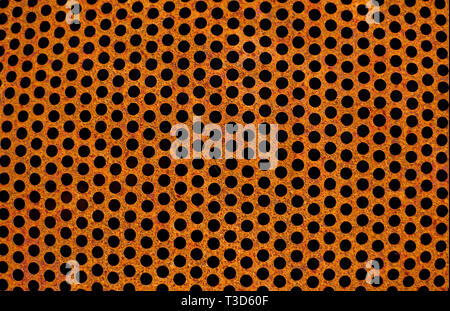 Perforated rusty  iron sheet texture. Surface of industrial mesh. Horizontal corrosion steel background. Top view - Stock Photo