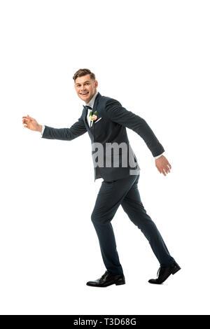 tricky cheerful bridegroom imitating running away isolated on white - Stock Photo