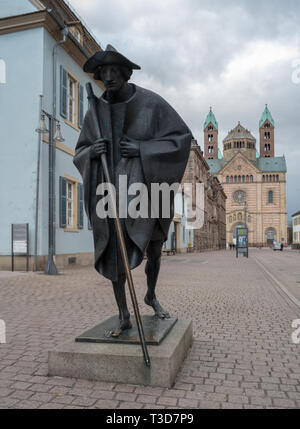 Travel, Germany, Rhineland Palatinate, Speyer, downtown, March 18. The Speyer Cathedral with a slightly cloudy sky. In front a scuplture called ' The  - Stock Photo