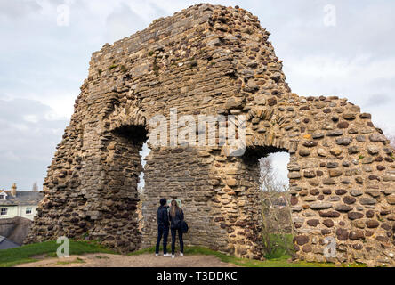 Tourists in the ruins of Christchurch Castle, Dorset England. - Stock Photo