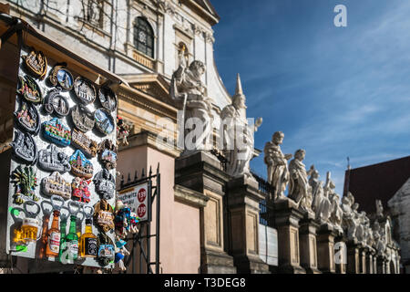 Krakow, Poland - March 22, 2019 - souvenirs for sale in front of The Church of Saints Peter and Paul - Stock Photo