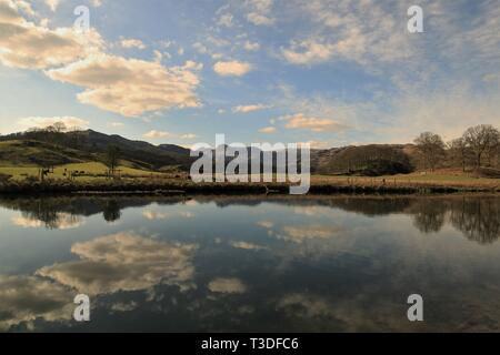 UK Elterwater, English Lake District Cumbria. View across the River Brathay towards the distant Langdale Pikes. Cumbria Way. Cumbrian Way. Skelwith UK - Stock Photo