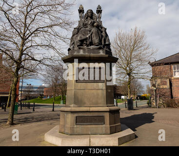 Statue of Queen Victoria on a throne St Helens Merseyside England March 2019 - Stock Photo