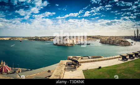 Valletta, Malta: View over Saluting Battery, Grand Harbor and Three Cities of Senglea, Birgu and Cospicua from Upper Barrakka Gardens - Stock Photo