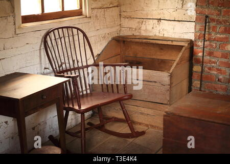 Interior of an American Pioneer Log Cabin - Stock Photo
