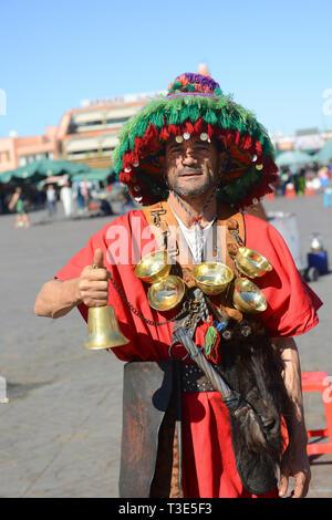 Portrait of a Water Seller on Djamaa El-Fna or Djemaa El Fna Square Marrakesh Morocco. - Stock Photo