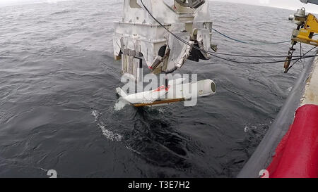 PANAMA CITY, Florida —The AN/AQS-20C Towed Mine-hunting Sonar is streamed into Gulf of Mexico waters of the Naval Surface Warfare Center Panama City Division (NSWC PCD) Gulf test range. Developmental Testing was completed on Feb. 12, 2019.  The testing marks completion of incorporating the 'Charlie' variant sonar sensor modernization. U.S. Navy photo by Eddie Green. - Stock Photo