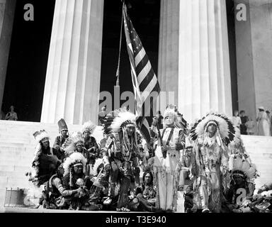 Native Americans with American Flag, in traditional clothing at U.S. Capitol ca. 1936 - Stock Photo