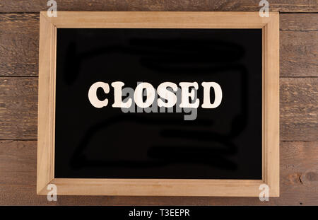 Blackboard Closed wrote - Stock Photo