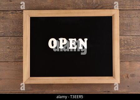 Blackboard with open written - Stock Photo