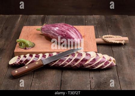 Zebra eggplant cutting board on board Stock Photo
