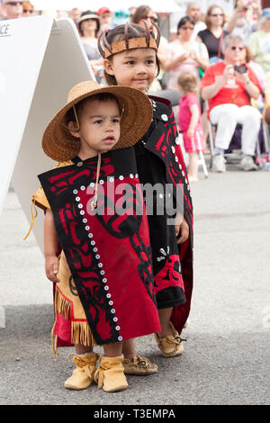 Native American children wearing traditional clothing at the Penn Cove Water Festival. Pacific Northwest Haida Tlingit Indian tribes. - Stock Photo
