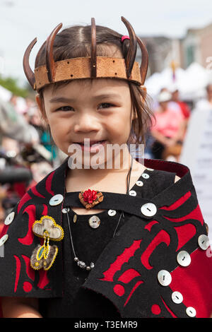 Happy, smiling, Native American child wearing traditional clothing at the Penn Cove Water Festival. Pacific Northwest Haida Tlingit Indian tribes. - Stock Photo