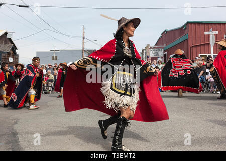 Native American Indian woman in traditional clothing dancing at the Whidbey Island Penn Cove Water Festival. Pacific Northwest Haida Tlingit tribes. - Stock Photo