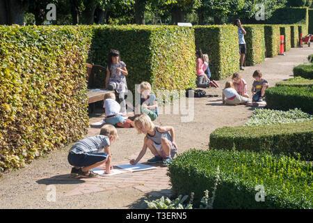 A class of young schoolchildren drawing in the King's Garden at Rosenborg Castle, Copenhagen - Stock Photo