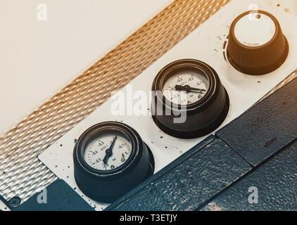 Manometers, indicators on equipment in the workshop, factory - Stock Photo
