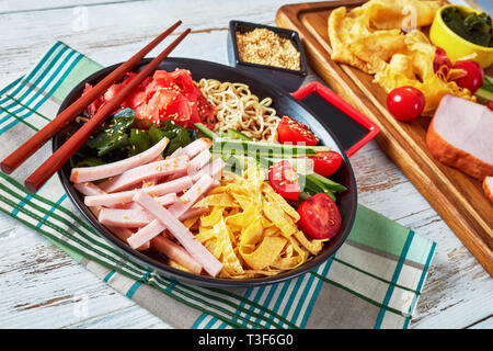 Hiyashi chuka, cold ramen - chilled Chinese-style egg noodles, with sweet vinegar sauce and topped with vegetables, strips of egg crepes and ham, view