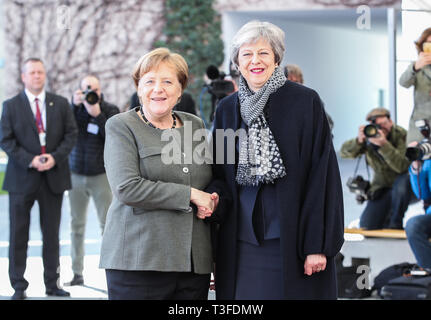 Berlin, Germany. 9th Apr, 2019. German Chancellor Angela Merkel (L) shakes hands with British Prime Minister Theresa May at the German Chancellery in Berlin, capital of Germany, on April 9, 2019. British Prime Minister Theresa May visited Berlin on Tuesday to discuss a way out of the deadlock of the Brexit process with German Chancellor Angela Merkel. Credit: Shan Yuqi/Xinhua/Alamy Live News - Stock Photo