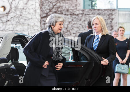 Berlin, Germany. 9th Apr, 2019. British Prime Minister Theresa May (L) arrives at the German Chancellery in Berlin, capital of Germany, on April 9, 2019. British Prime Minister Theresa May visited Berlin on Tuesday to discuss a way out of the deadlock of the Brexit process with German Chancellor Angela Merkel. Credit: Shan Yuqi/Xinhua/Alamy Live News - Stock Photo
