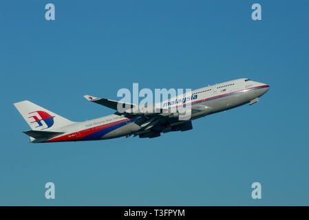 Malaysia Airlines Boeing 747 Jumbo Jet jet airliner plane 9M-MPH taking off from London Heathrow Airport, London, UK in blue sky with space for copy - Stock Photo