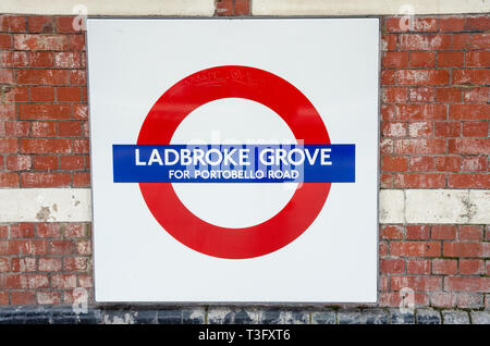 Name plate for Ladbroke Groce London Underground Railway Station mounted on a brick wall. - Stock Photo