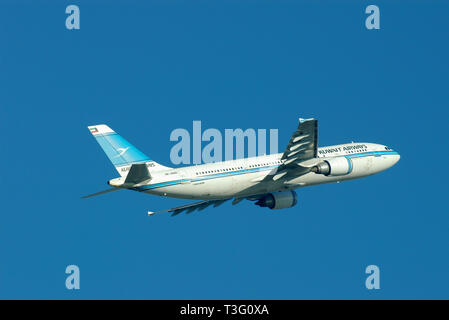 Kuwait Airways Airbus A300 jet airliner plane 9K-AMA taking off from London Heathrow Airport, London, UK in blue sky with space for copy - Stock Photo