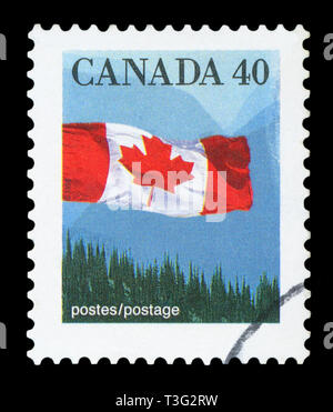 CANADA - CIRCA 1990: A stamp printed in Canada shows Canadian flag and Hills, circa 1990. - Stock Photo