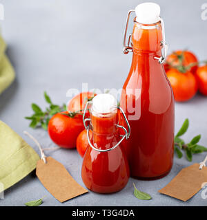 Homemade tomato ketchup in glass bottles - Stock Photo