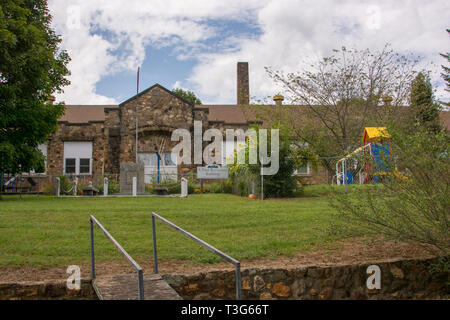 The unique Webster Rock School is on the National Register of Historic Places. It is well preserved & serves the community in other ways present day. - Stock Photo